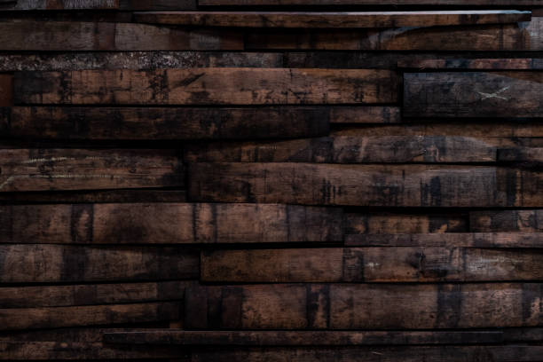 used bourbon barrel staves on wall - cask foto e immagini stock