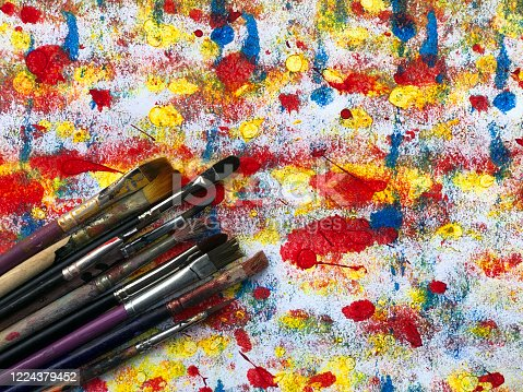 Vintage stylized photo of paintbrushes closeup and artist palett