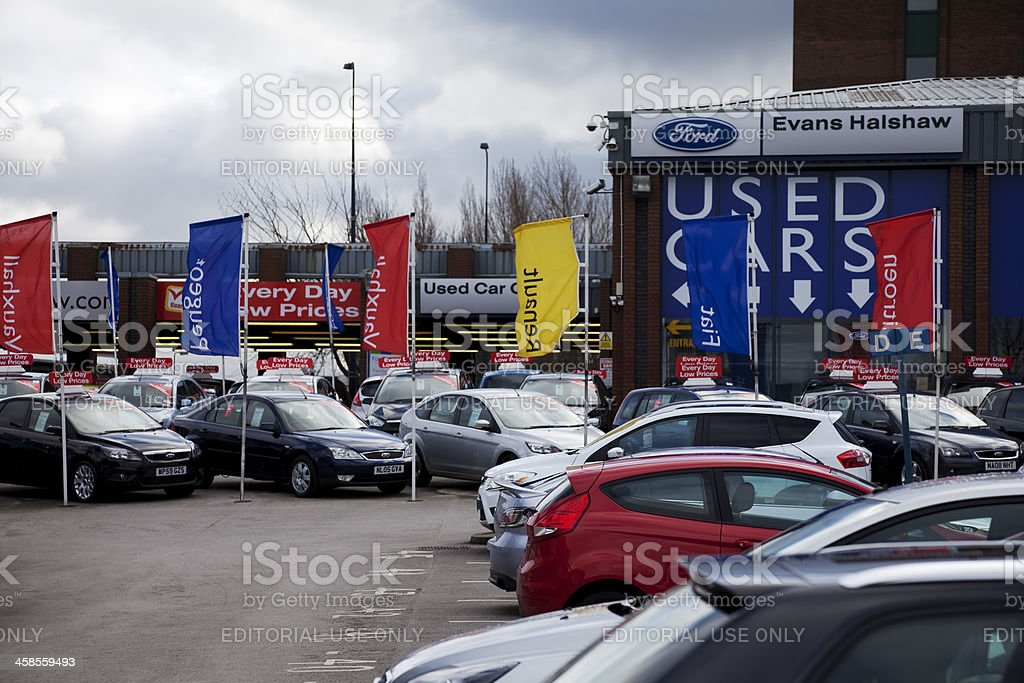 Used car lot, no customers, storm clouds stock photo