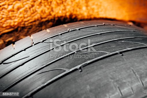 istock used car tire with worn-out depth of thread 533437112