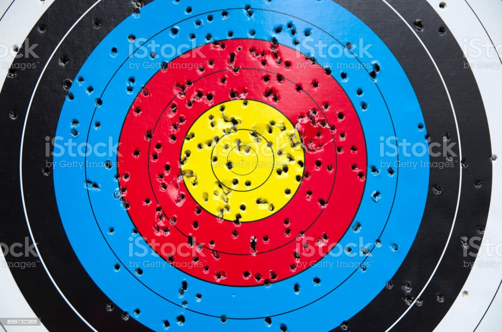 Used cardboard colorful target with holes closeup stock photo