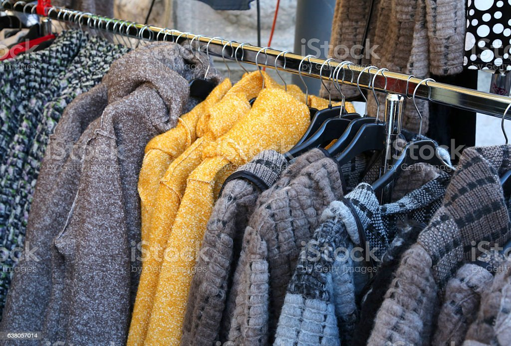 Used clothes and many winter clothes stock photo