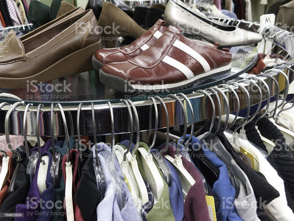 Used Clothes and Shoes at Thrift Store stock photo