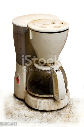 A very used and dirty coffee machine isolated.