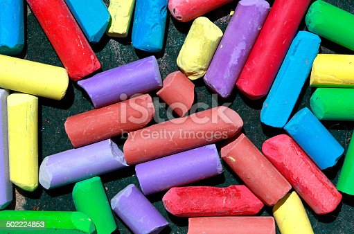 623300522 istock photo Used colored chalks in a box 502224853