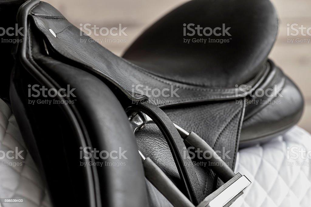 Used Dressage Riding Saddle and Stirrup stock photo
