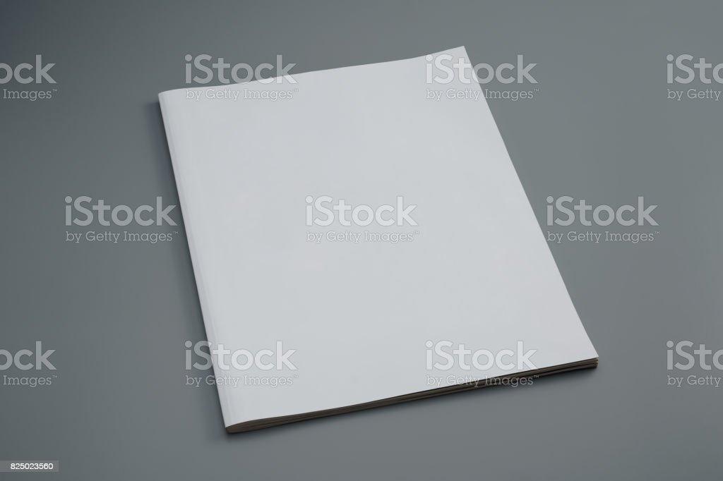 Used dummy magazine on gray background stock photo