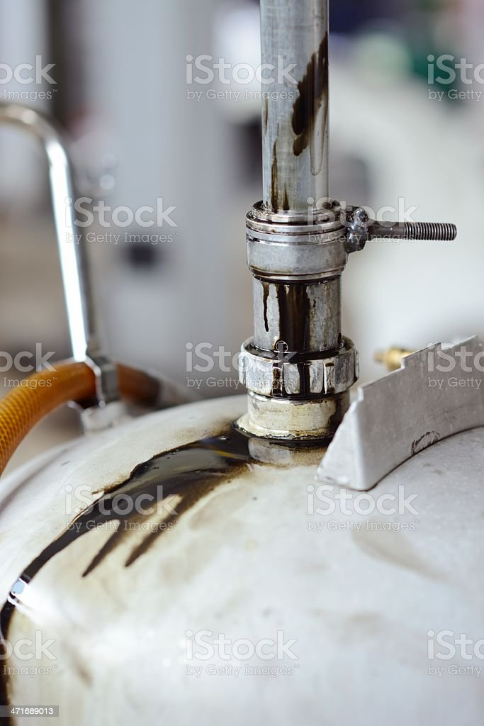 Used Engine Oil Container in Workshop royalty-free stock photo