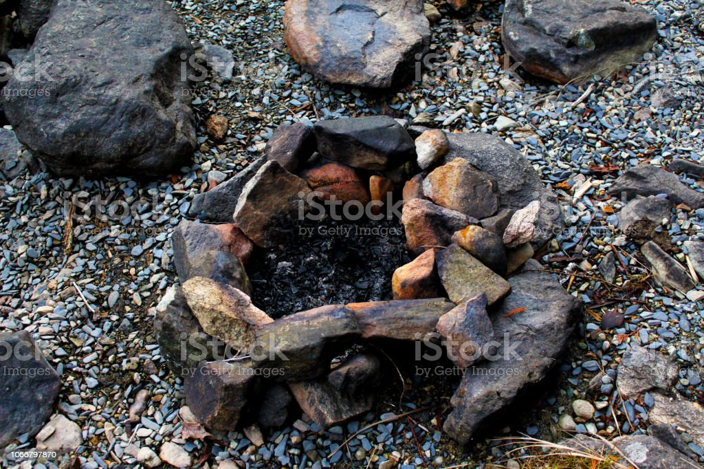 A Used Firepit On The Beach Of Cheakamus Lake As The Sun Sets Stock