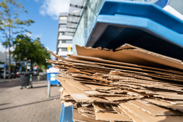 Used flattened cardboard boxes in a container stock photo