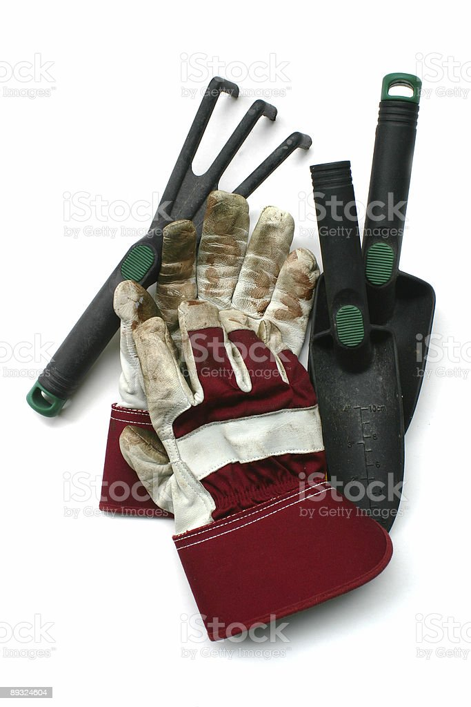 Used gardening / work gloves and tools stock photo