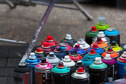 Saint Petersburg, Russia  - July, 2020: Cans of paints. Street art concept, used graffiti spray cans