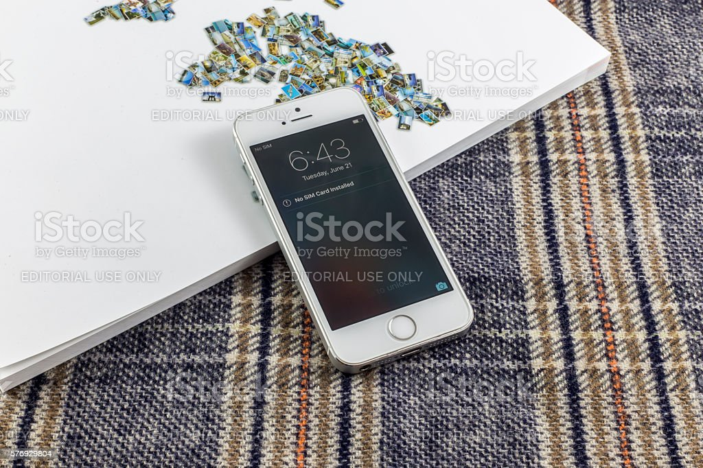 Used Iphone 5S on a magazine stock photo