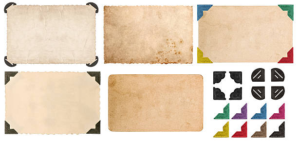 used look cardboards with photo corner. photo frames - photo corner stock photos and pictures