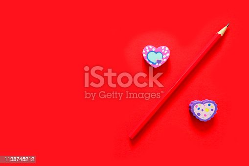 istock Used Love Pink and Purple Eraser Symbol for Valentine Day Concept. Education Toy Top View. Colorful Heart Erasers and Red Pencil Isolated on Red Paper Color Background with Banner, Clean Copy Space. 1138745212