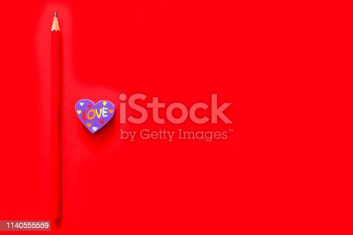 istock Used Love Pink and Purple Eraser Symbol for Valentine Day Concept. Education Toy Top View. Colorful Heart Erasers and Red Pencil Isolated on Red Paper Color Background with Banner, Clean Copy Space. 1140555559