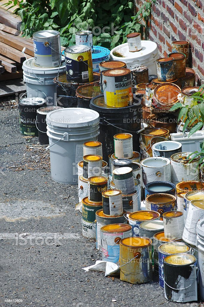 Used paint cans stock photo