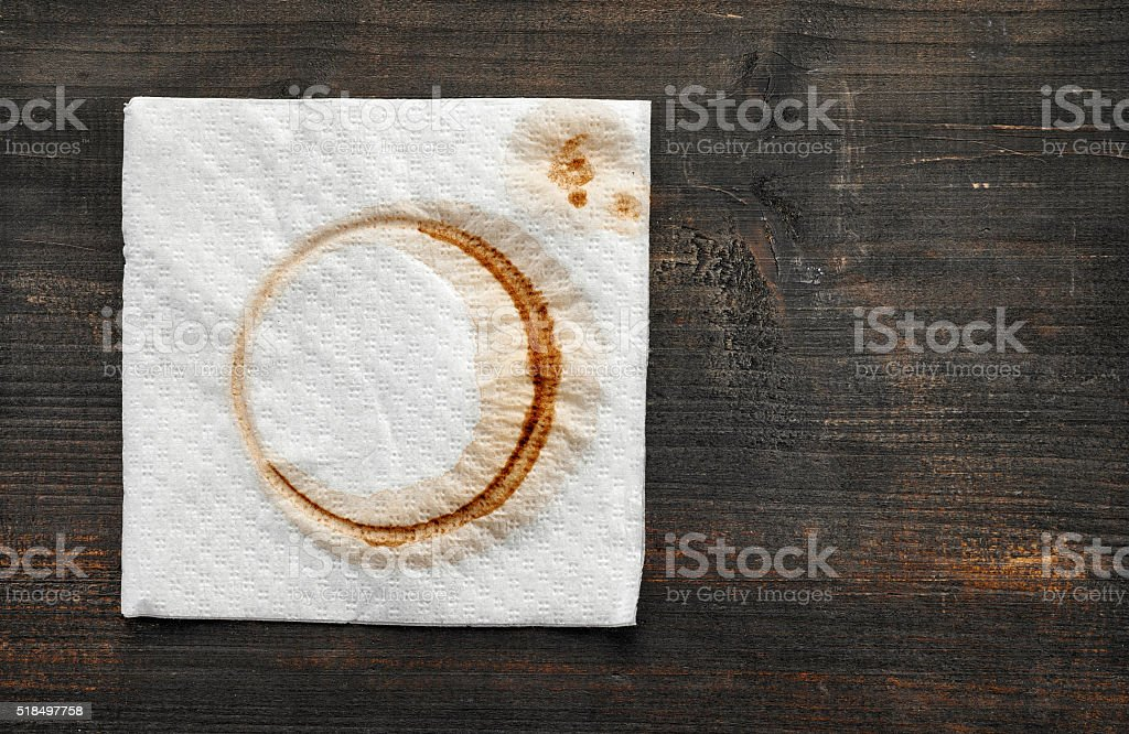 used paper napkin on dark wooden table stock photo
