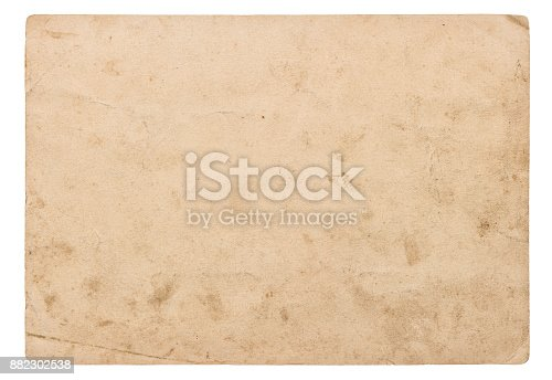 istock Used paper sheet isolated white background Vintage cardboard 882302538