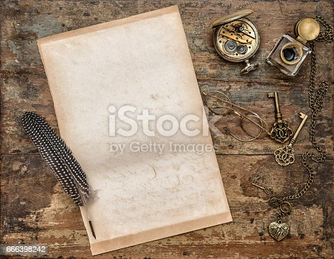 istock Used paper sheet vintage writing tools wooden background 666398242