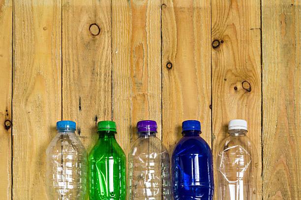 used plastic bottles on wooden board - pet bottles bildbanksfoton och bilder