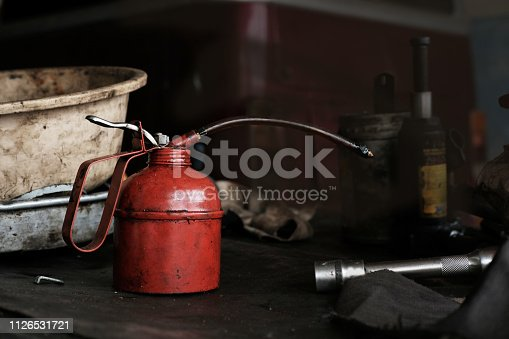 Used Red Oil Can in Garage