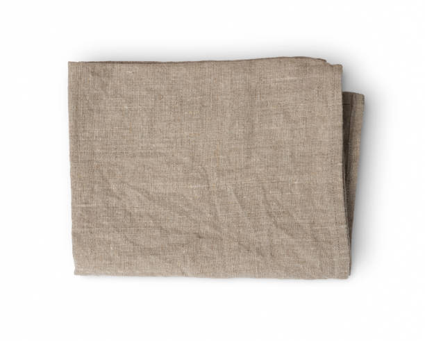 Used rumpled folded linen kitchen towel isolated on white background stock photo