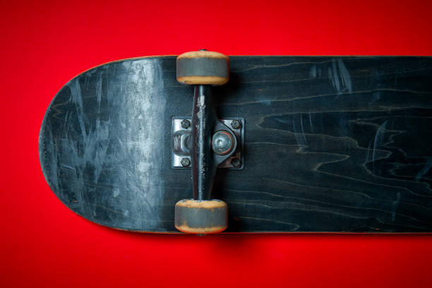 used skateboard on a red background