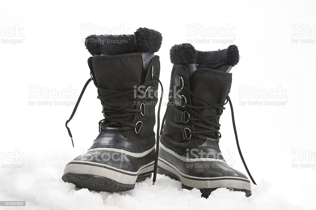 Used snow boots on ice, in studio. royalty-free stock photo