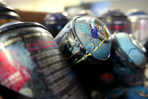 Used Spray Paint Cans with Paint All Over