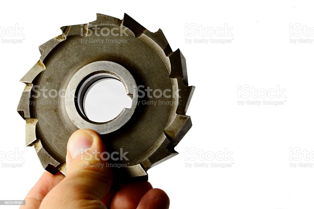 Used staggered tooth mill from tool steel held in left hand on white background stock photo