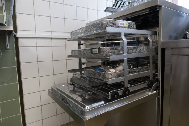 used surgical instruments are in a washing machine - commercial dishwasher stock photos and pictures