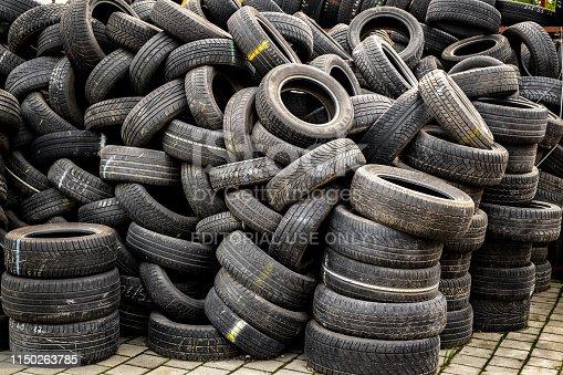 Sibiu, Romania - May 04, 2019. Used tire stacks in Workshop vulcanization yard