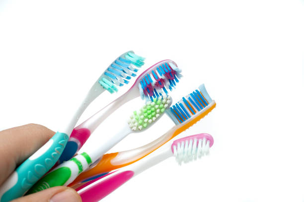 used toothbrushes on a white background stock photo