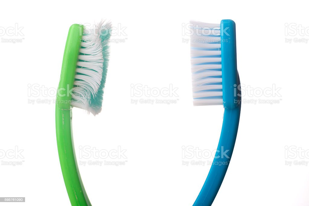 Used toothbrushes on white stock photo