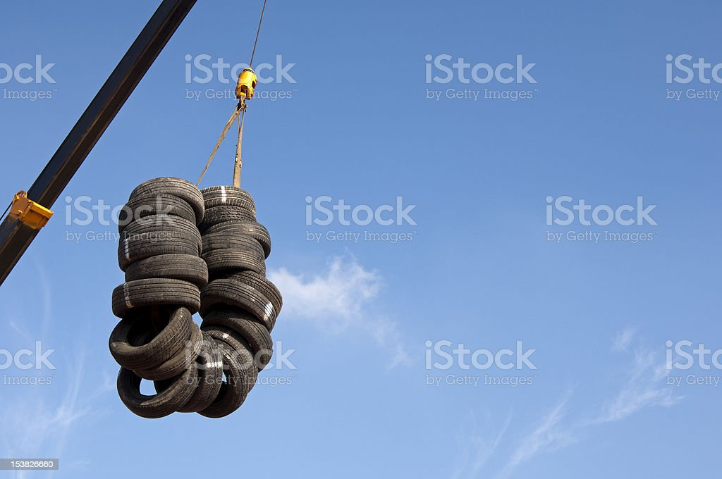 Used tyres hanging on a crane royalty-free stock photo