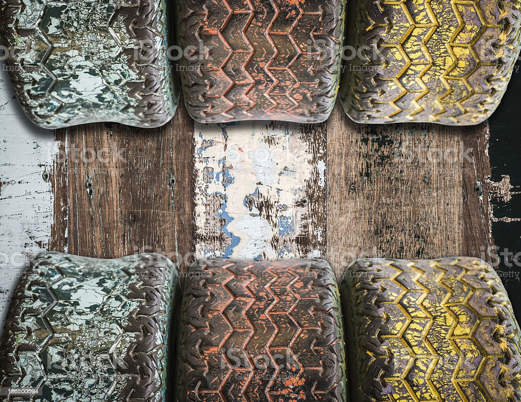 used tyres on wooden board background royalty-free stock photo