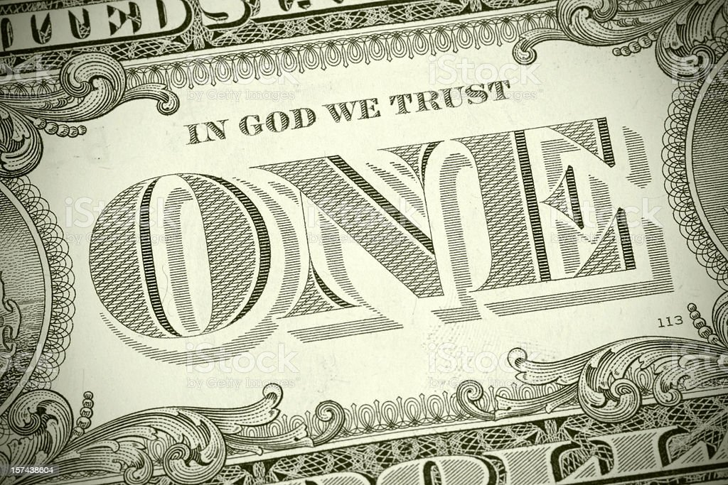 Used US one dollar banknote with emphasis on 'ONE', toned stock photo