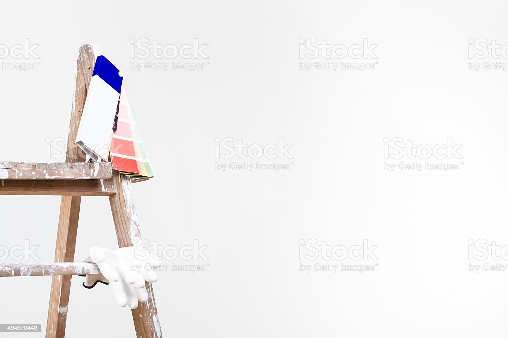 used vintage ladder with palette and gloves stock photo