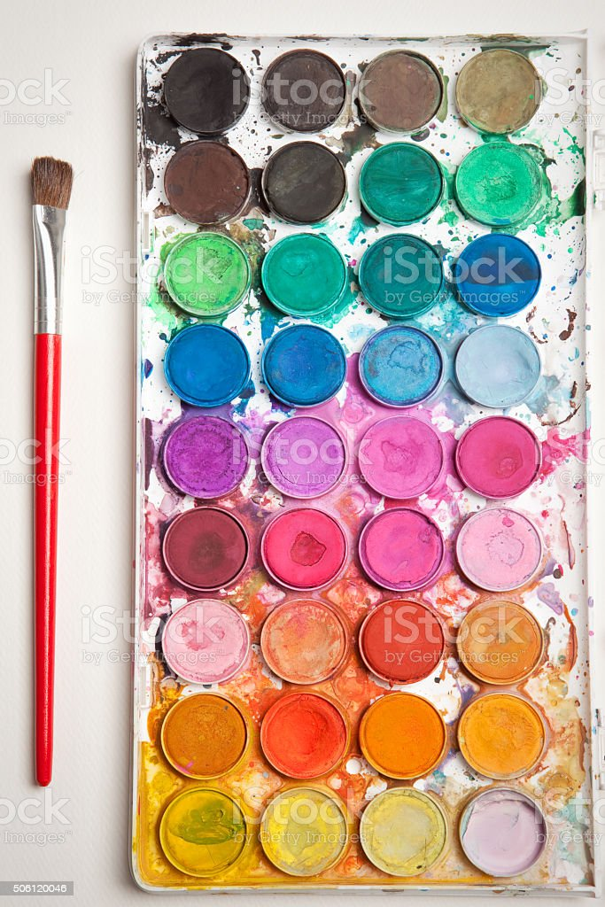 Used Watercolor Paints And Brush stock photo