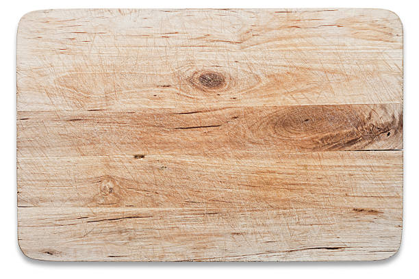 Used wooden chopping board, isolated on white, clipping path stock photo