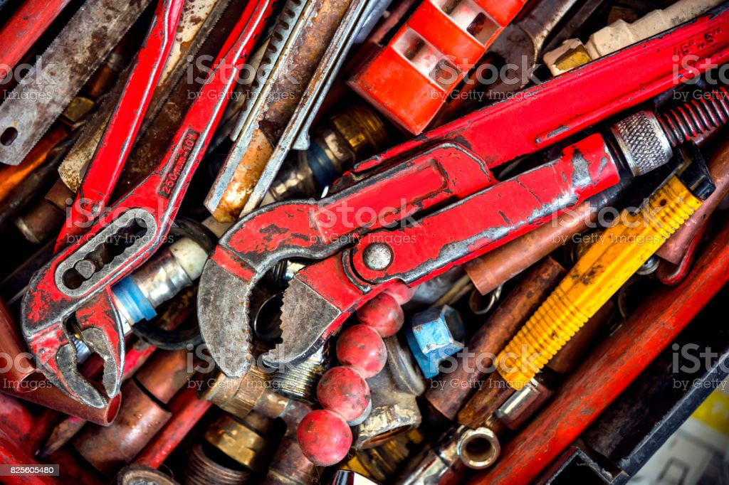 used worn plumber tools equipment stock photo