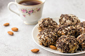 istock Useful homemade almond cake with coconut flakes on a light background and a cup of tea, copy space - Image 1179813413