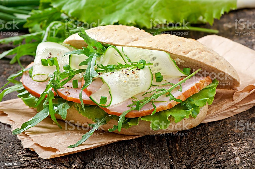 Useful sandwich with ham and herbs royalty-free stock photo