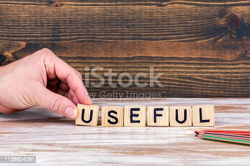 Useful. Wooden letters on the office desk, informative and communication background