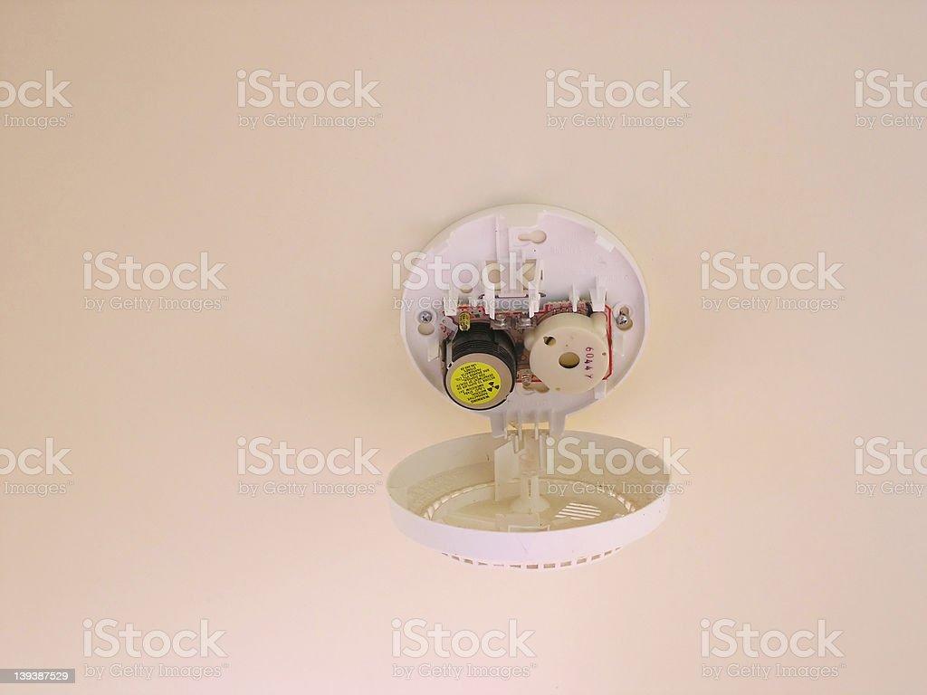 Useless smoke detector bildbanksfoto