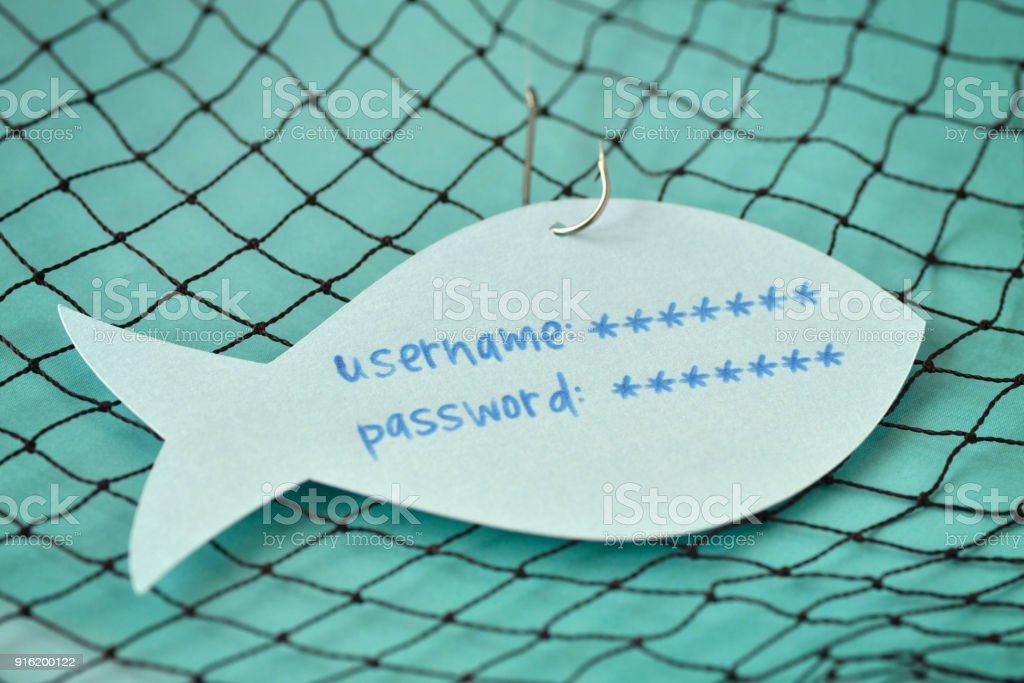 Username and password written on a paper note in the shape of a fish attached to a hook - Phishing and internet security concept stock photo