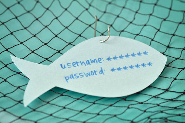 username and password written on a paper note in the shape of a fish attached to a hook - phishing and internet security concept - phishing stock photos and pictures