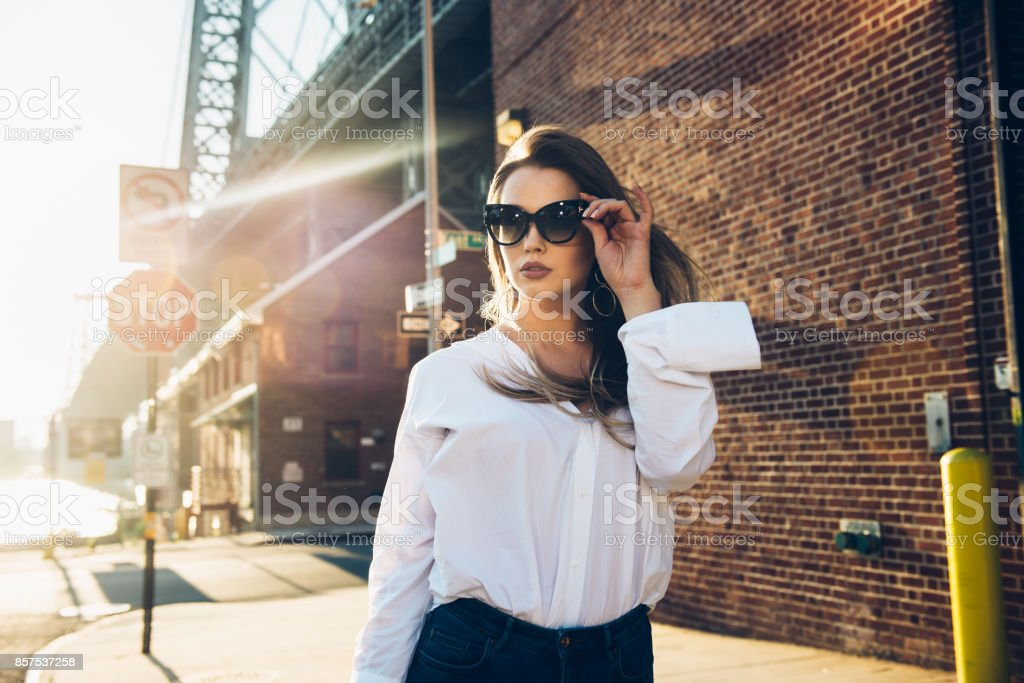 usiness woman wearing sunglasses and white t-shirt stock photo