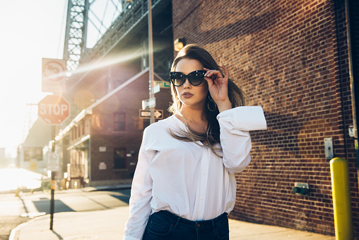Usiness Woman Wearing Sunglasses And White Tshirt Stock Photo - Download Image Now